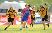 4 July 2010; Caitlin McKenna, New York, in action against Lauren Dwyer, left, and Roisin Byrne, Tinryland Bennekerry, Carlow, during the Division 4 Girls Final. Coca-Cola GAA Féile Peil na nÓg Finals 2010, Celtic Park, Derry. Picture credit: Paul Mohan / SPORTSFILE