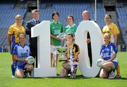 5 July 2010; 2010 marks the 10 year milestone of TG4's sponsorship of the Ladies Football All Ireland Championships and the tenth year of the Ladies Football finals being televised by the national Irish language broadcaster. TG4 who became the title sponsors of the Ladies Football Championships in 2000 will broadcast 15 live championship games over the course of the summer. At the launch of the 2010 TG4 Ladies Football Championships at Croke Park is Pól Ó'Gallchóir, Ceannasai, TG4, left, and Pat Quill, Uachtarán, Cumann Peil Gael na mBan, with Intermediate players, back row, from left, Emer Casey, Roscommon, Aoife McDonald, Fermanagh, Aine McBrien, Fermanagh, and Caroline Kelly, Antrim, with, front row, from left, Michelle Ross, Longford, Layrena Murphy, Kilkenny, and Mary Foley, Waterford. Croke Park, Dublin. Picture credit: Brendan Moran / SPORTSFILE