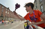 6 June 2016; Ned O'Meara, age 8, from Mullinahone, Co. Tipperary, claps on runners at the finish line of the 2016 Vhi Women's Mini Marathon which saw 35,000 participants take to the streets of Dublin to run, walk and jog the 10km route, raising much needed funds for hundreds of charities around the country. For further information please log on to www.vhiwomensminimarathon.ie. Photo by Cody Glenn/Sportsfile
