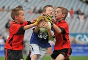 6 July 2010; Sean Mulleady, Tang/Maryland, Co. Westmeath, in action against Jake Kirwan, left, and Ryan Stronge, Na Fianna, Co. Offaly, during the 'Play & Stay with the GAA' Activity Days. Croke Park, Dublin. Picture credit: Barry Cregg / SPORTSFILE