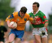1 July 2001; Conor Connelly of Roscommon in action against Noel Connelly of Mayo during the Bank of Ireland Connacht Senior Football Championship Final match between Roscommon and Mayo at Dr. Hyde Park in Roscommon. Photo by David Maher/Sportsfile