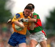 1 July 2001; Conor Connelly of Roscommon is tackled by Noel Connelly of Mayo during the Bank of Ireland Connacht Senior Football Championship Final match between Roscommon and Mayo at Dr. Hyde Park in Roscommon. Photo by David Maher/Sportsfile