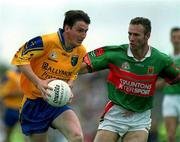 1 July 2001; Conor Connelly of Roscommon in action against Conor McManaman of Mayo during the Bank of Ireland Connacht Senior Football Championship Final match between Roscommon and Mayo at Dr. Hyde Park in Roscommon. Photo by David Maher/Sportsfile