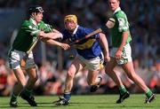 1 July 2001; Eamonn Corcoran, Tipperary, in action against Mark Keane, Limerick. Tipperary v Limerick, Guinness Munster Senior Hurling Final, Pairc Ui Chaoimh, Co. Cork. Picture credit; Ray McManus / SPORTSFILE