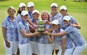 12 June 2016; The GB&I team, from left, team manager Helen Hewlett, Olivia Mehaffey, Leona Maguire, Meghan MacLaren, Charlotte Thomas, team captain Elaine Farquharson-Black, Bronte Law, Alice Hewson, Maria Dunne and Rochelle Morris celebrate with the Curtis Cup after GB&I beat the USA to win the Curtis Cup during day three of the Curtis Cup Matches at Dun Laoghaire Golf Club in Enniskerry, Co. Wicklow. Photo by Matt Browne/Sportsfile