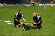 12 June 2016; Linesmen Rory Hickey, left, and Cormac Reilly stretch ahead of their Munster GAA Football Senior Championship Semi-Final match between Tipperary and Cork at Semple Stadium in Thurles, Co Tipperary. Photo by Piaras Ó Mídheach/Sportsfile