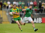 12 June 2016; Christy Toye of Donegal in action against James McMahon of Fermanagh during their Ulster GAA Football Senior Championship Quarter-Final match between Fermanagh and Donegal at MacCumhaill Park in Ballybofey, Co. Donegal. Photo by Oliver McVeigh/Sportsfile