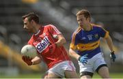 12 June 2016; Kevin O'Driscoll of Cork in action against Brian Fox of Tipperary during their Munster GAA Football Senior Championship Semi-Final match between Tipperary and Cork at Semple Stadium in Thurles, Co Tipperary. Photo by Piaras Ó Mídheach/Sportsfile