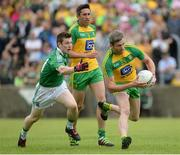 12 June 2016; Christy Toye of Donegal in action against Daniel Teague of Fermanagh during their Ulster GAA Football Senior Championship Quarter-Final match between Fermanagh and Donegal at MacCumhaill Park in Ballybofey, Co. Donegal. Photo by Oliver McVeigh/Sportsfile