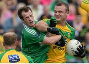 12 June 2016; Neil McGee of Donegal strikes out at Ruairi Corrigan of Fermanagh, McGee was subsequently shown a red card and a penalty was awarded, during their Ulster GAA Football Senior Championship Quarter-Final match between Fermanagh and Donegal at MacCumhaill Park in Ballybofey, Co. Donegal. Photo by Oliver McVeigh/Sportsfile