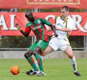 15 July 2010; Baba Diawara, CS Marítimo, in action against Colin Hawkins, Sporting Fingal. UEFA Europa League Second Qualifying Round - 1st Leg, CS Marítimo v Sporting Fingal, Estádio da Madeira, Funchal, Madeira, Portugal. Picture credit: Helder Santos / SPORTSFILE