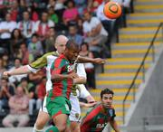 15 July 2010; Sporting Fingal's Glen Crowe heads to score his side's first goal despite the challenge of CS Marítimo's Roberto Sousa. UEFA Europa League Second Qualifying Round - 1st Leg, CS Marítimo v Sporting Fingal, Estádio da Madeira, Funchal, Madeira, Portugal. Picture credit: Helder Santos / SPORTSFILE