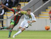 15 July 2010; Shane McFaul, Sporting Fingal, in action against Tcho, CS Marítimo. UEFA Europa League Second Qualifying Round - 1st Leg, CS Marítimo v Sporting Fingal, Estádio da Madeira, Funchal, Madeira, Portugal. Picture credit: Helder Santos / SPORTSFILE