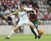 15 July 2010; Kenny Browne, Sporting Fingal, in action against Tcho, CS Marítimo. UEFA Europa League Second Qualifying Round - 1st Leg, CS Marítimo v Sporting Fingal, Estádio da Madeira, Funchal, Madeira, Portugal. Picture credit: Helder Santos / SPORTSFILE