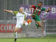 15 July 2010; Glen Crowe, Sporting Fingal, in action against Robson, CS Marítimo. UEFA Europa League Second Qualifying Round - 1st Leg, CS Marítimo v Sporting Fingal, Estádio da Madeira, Funchal, Madeira, Portugal. Picture credit: Helder Santos / SPORTSFILE