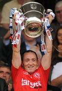 18 July 2010; Tyrone captain Brian Dooher lifts the Anglo Celt cup after the game. Ulster GAA Football Senior Championship Final, Monaghan v Tyrone, St Tighearnach's Park, Clones, Co. Monaghan. Picture credit: Brendan Moran / SPORTSFILE