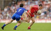 18 July 2010; Brian Dooher, Tyrone, in action against Gary McQuaid, Monaghan. Ulster GAA Football Senior Championship Final, Monaghan v Tyrone, St Tighearnach's Park, Clones, Co. Monaghan. Picture credit: Brendan Moran / SPORTSFILE