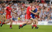 18 July 2010; Owen Lennon, Monaghan, in action against Kevin Hughes and Brian Dooher, Tyrone. Ulster GAA Football Senior Championship Final, Monaghan v Tyrone, St Tighearnach's Park, Clones, Co. Monaghan. Picture credit: Brendan Moran / SPORTSFILE
