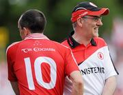 18 July 2010; Tyrone manager Mickey Harte congratulates his captain Brian Dooher, after replacing him late in the game. Ulster GAA Football Senior Championship Final, Monaghan v Tyrone, St Tighearnach's Park, Clones, Co. Monaghan. Picture credit: Oliver McVeigh / SPORTSFILE
