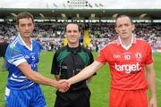 18 July 2010; Monaghan captain Damien Freeman, left and Tyrone Captain Brian Dooher shake hands in front of Referee David Coldrick. Ulster GAA Football Senior Championship Final, Monaghan v Tyrone, St Tighearnach's Park, Clones, Co. Monaghan. Picture credit: Oliver McVeigh / SPORTSFILE