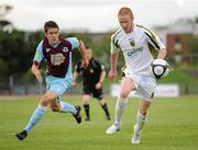 19 July 2010; Keith Quinn, Sporting Fingal, in action against Eric McGill, Drogheda United. Airtricity League Premier Division, Sporting Fingal v Drogheda United, Morton Stadium, Santry, Dublin. Picture credit: Barry Cregg / SPORTSFILE