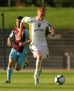 19 July 2010; Keith Quinn, Sporting Fingal, in action against Darren Meehan, Drogheda United. Airtricity League Premier Division, Sporting Fingal v Drogheda United, Morton Stadium, Santry, Dublin. Picture credit: Barry Cregg / SPORTSFILE