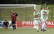 20 July 2010; The New Saints FC's Matty Williams, right, celebrates after scoring his side's second goal with team-mates Scott Ruscoe, left, and Barry Hogan as Bohemians' Conor Powell and Mark Quigley look away. UEFA Champions League First Qualifying Round, 2nd Leg, The New Saints FC v Bohemians, Park Hall Stadium, Oswestry, Wales. Picture credit: David Maher / SPORTSFILE