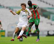 22 July 2010; Shane Mvfaul, Sporting Fingal, intercepts  Papa Babacar Diawara, CS Marítimo. UEFA Europa League Second Qualifying Round, 2nd Leg, Sporting Fingal v CS Marítimo, Dalymount Park, Dublin. Picture credit: Barry Cregg / SPORTSFILE