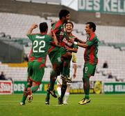 22 July 2010; Alonso Ferreira de Matos, CS Marítimo, celebrates with his team-mates after scoring his side's first goal. UEFA Europa League Second Qualifying Round, 2nd Leg, Sporting Fingal v CS Marítimo, Dalymount Park, Dublin. Picture credit: Barry Cregg / SPORTSFILE