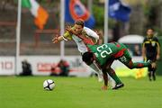 22 July 2010; Valdecir Souza Junior, CS Marítimo, tries to stop Ger O'Brien, Sporting Fingal, from getting to the ball. UEFA Europa League Second Qualifying Round, 2nd Leg, Sporting Fingal v CS Marítimo, Dalymount Park, Dublin. Picture credit: Barry Cregg / SPORTSFILE