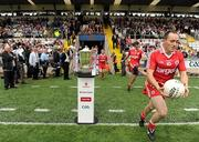 18 July 2010; Tyrone captain Brian Dooher runs out past the Anglo Celt cup before the game. Ulster GAA Football Senior Championship Final, Monaghan v Tyrone, St Tighearnach's Park, Clones, Co. Monaghan. Picture credit: Brendan Moran / SPORTSFILE