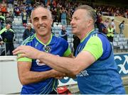 18 June 2016; Laois manager Mick Lillis, right, and selector Anthony Cunningham celebrate after the GAA Football All-Ireland Senior Championship Qualifier Round 1A match between Laois and Armagh at O'Moore Park in Portlaoise, Co. Laois. Photo by Matt Browne/Sportsfile
