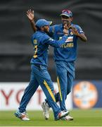 16 June 2016; Kusal Mendis of Sri Lanka is congratulated by teammate Farees Maharoof after catching John Anderson of Ireland on the boundary off a Seekuge Prasanna delivery during the One Day International match between Ireland and Sri Lanka at Malahide Cricket Ground in Malahide, Dublin. Photo by Seb Daly/Sportsfile