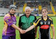 24 July 2010; Referee Eamon Browne with team captains Una Leacy, Wexford, and Ann Dalton, Kilkenny. Gala All-Ireland Senior Camogie Championship, Wexford v Kilkenny, Wexford Park, Wexford. Picture credit: Matt Browne / SPORTSFILE