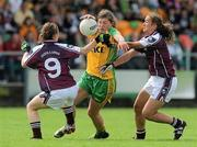 24 July 2010; Ciara Hegarty, Donegal, in action against Maria Connell, left, and Dora Gorman, Galway. Ladies Gaelic Football Minor A Championship All-Ireland Final, Donegal v Galway, Seán O'Heslin GAA Cub, Ballinamore, Co. Leitrim. Picture credit: Brian Lawless / SPORTSFILE