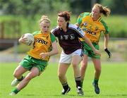 24 July 2010; Maria Connell, Galway, in action against Niamh McLaughlin and Orlaith Furlong, right, Donegal. Ladies Gaelic Football Minor A Championship All-Ireland Final, Donegal v Galway, Seán O'Heslin GAA Cub, Ballinamore, Co. Leitrim. Picture credit: Brian Lawless / SPORTSFILE
