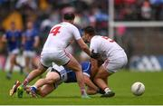 19 June 2016; Seanie Johnston of Cavan is tackled by Cathal McCarron, left, and Tiernan McCann of Tyrone during the Ulster GAA Football Senior Championship Semi-Final match between Tyrone and Cavan at St Tiernach's Park in Clones, Co Monaghan. Photo by Ramsey Cardy/Sportsfile