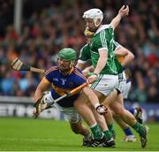 19 June 2016; James Barry of Tipperary in action against Cian Lynch and Paul Browne of Limerick during the Munster GAA Hurling Senior Championship Semi-Final match between Limerick and Tipperary at Semple Stadium in Thurles, Co Tipperary. Photo by Ray McManus/Sportsfile