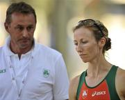 28 July 2010; Ireland's Olive Loughnane with Athletics Ireland High Performance Consultant Chris Jones after pulling out of the Women's 20k Walk Final. 20th European Athletics Championships Montjuïc Olympic Stadium, Barcelona, Spain. Picture credit: Brendan Moran / SPORTSFILE