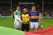 19 June 2016; Tipperary captain Brendan Maher and Limerick captain Nickie Quaid shake hands in front of referee James McGrath ahead of the Munster GAA Hurling Senior Championship Semi-Final match between Limerick and Tipperary at Semple Stadium in Thurles, Co Tipperary. Photo by Ray McManus/Sportsfile