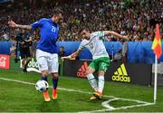 22 June 2016; Stephen Ward of Republic of Ireland in action against Federico Bernardeschi of Italy during the UEFA Euro 2016 Group E match between Italy and Republic of Ireland at Stade Pierre-Mauroy in Lille, France. Photo by Stephen McCarthy/Sportsfile