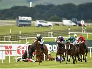 25 June 2016; Breathe Easy, with Wayne Lordan up, on their way to winning the Paddy Power Handicap after Elusive Heights, with Colin Keane up, collided with Johann Bach, with Gary Halpin up, who fell on the final straight, breaking through the rail at the Curragh Racecourse in the Curragh, Co. Kildare. Photo by Cody Glenn/Sportsfile