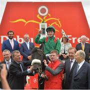 25 June 2016; Pat Smullen celebrates on Harzand alongside trainer Dermot Weld, second from right, in the winner's enclosure after the Dubai Duty Free Irish Derby at the Curragh Racecourse in the Curragh, Co. Kildare. Photo by Cody Glenn/Sportsfile
