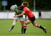 25 June 2016; Amee Leigh Murphy Crowe of Ireland is tackled by Zhang Wanting of China during the World Rugby Women's Sevens Olympic Repechage Pool C match between Ireland and China at UCD Sports Centre in Belfield, Dublin. Photo by Seb Daly/Sportsfile