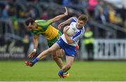 25 June 2016; Conor McCarthy of Monaghan is tackled by Karl Lacey of Donegal during the Ulster GAA Football Senior Championship Semi-Final game between Donegal and Monaghan at Kingspan Breffni Park in Cavan. Photo by Ramsey Cardy/Sportsfile