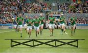 25 June 2016; The Meath players make their way to the bench for the pre-game team photograph prior to the Christy Ring Cup Final Replay between Antrim and Meath at Croke Park in Dublin. Photo by Piaras Ó Mídheach/Sportsfile