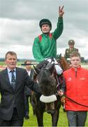25 June 2016; Pat Smullen celebrates winning the Dubai Duty Free Irish Derby on Harzand at the Curragh Racecourse in the Curragh, Co. Kildare. Photo by Cody Glenn/Sportsfile