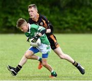 25 June 2016; Darragh Fleming of Legoin in action against James Fernane of Austin Stacks during the John West Féile Peile na nÓg at Dr Crokes in Killarney. Photo by Michelle Cooper Galvin/Sportsfile