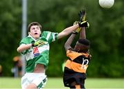 25 June 2016; Eoghan O'Sullivan of Legoin in action against Mervyn Fernane of Austin Stacks during the John West Féile Peile na nÓg at Dr Crokes in Killarney. Photo by Michelle Cooper Galvin/Sportsfile