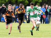 25 June 2016; Eoghan O'Sullivan of Legoin in action against Adam Curran and Mervyn Fernane of Austin Stacks during the John West Féile Peile na nÓg at Dr Crokes in Killarney. Photo by Michelle Cooper Galvin/Sportsfile